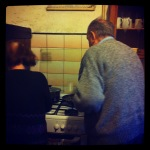 My only photo of my grandparents cooking, taking before that whole world disappeared.